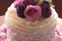 Lilac ombre ruffled cutting cake