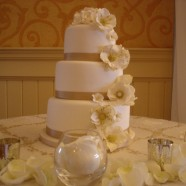 Gold ribbon wedding cake
